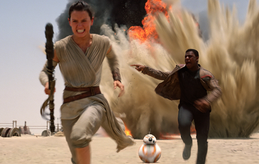 Rey, Finn and BB-8 running from an explosion