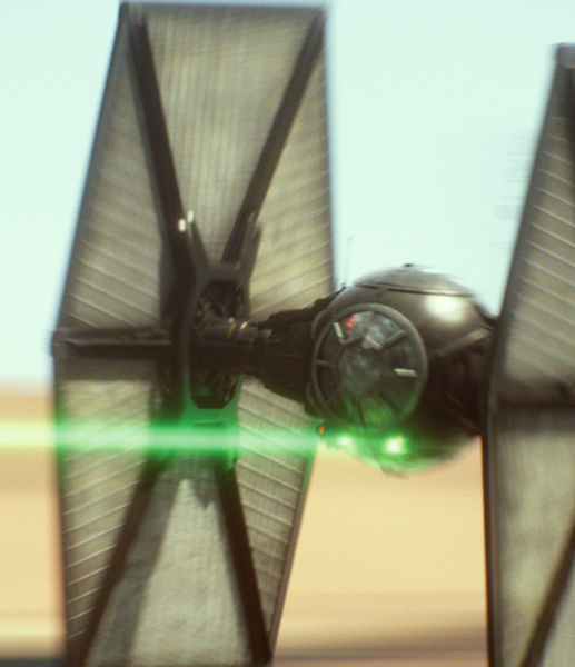 A First Order TIE fighter shooting a green laser beam